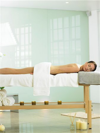 Cropped full length of woman on spa massage bed Stock Photo - Rights-Managed, Code: 847-02782311