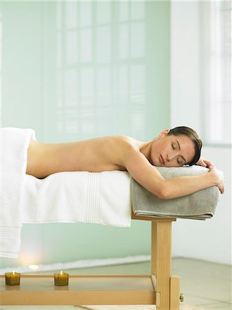 Woman lying on massage table in spa location Stock Photo - Rights-Managed, Code: 847-02782320