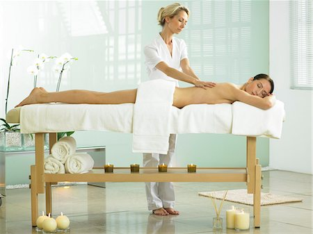 Full length of woman on spa massage bed with therapist Stock Photo - Rights-Managed, Code: 847-02782344