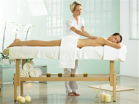 Full length of woman on spa massage bed with therapist Stock Photo - Rights-Managed, Code: 847-02782346