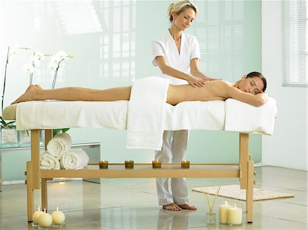 Full length of woman on spa massage bed with therapist Stock Photo - Rights-Managed, Code: 847-02782347