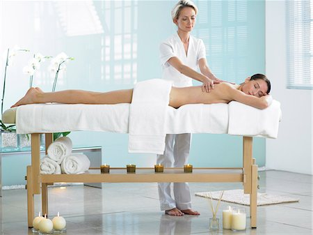 Full length of woman on spa massage bed with therapist Stock Photo - Rights-Managed, Code: 847-02782348