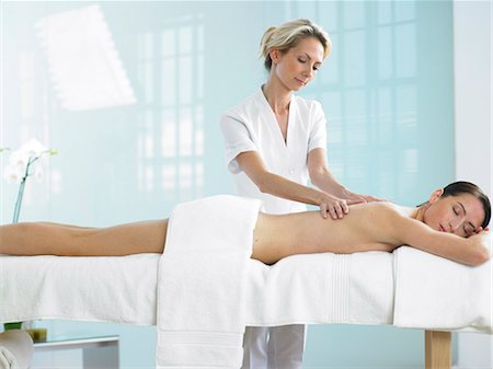 Cropped full length of woman on spa massage bed with therapist Stock Photo - Rights-Managed, Code: 847-02782349