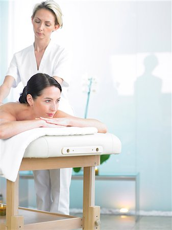 Radiant woman on spa massage bed with therapist Stock Photo - Rights-Managed, Code: 847-02782355