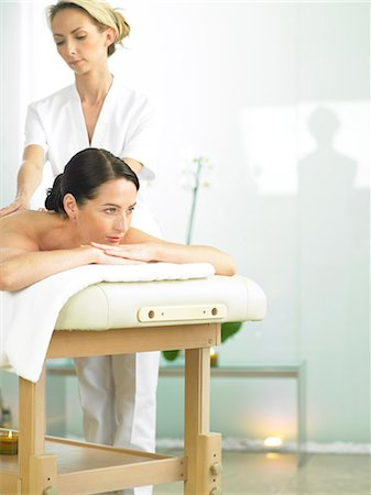 Radiant woman on spa massage bed with therapist Stock Photo - Rights-Managed, Code: 847-02782356