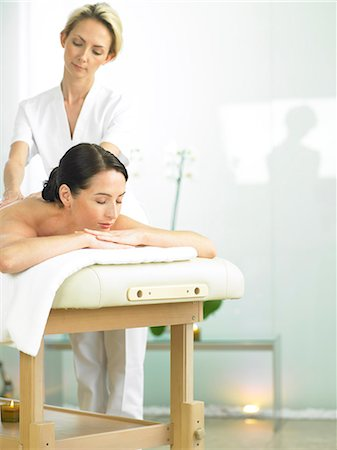 Radiant woman on spa massage bed with therapist Stock Photo - Rights-Managed, Code: 847-02782357