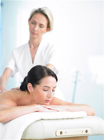 Radiant woman on spa massage bed with therapist Stock Photo - Rights-Managed, Code: 847-02782358