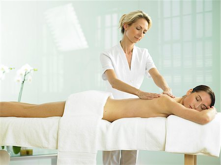 Cropped full length of woman on spa massage bed with therapist Stock Photo - Rights-Managed, Code: 847-02782350