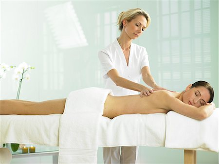 Cropped full length of woman on spa massage bed with therapist Stock Photo - Rights-Managed, Code: 847-02782351