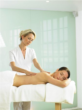 Cropped full length of woman on spa massage bed with therapist Stock Photo - Rights-Managed, Code: 847-02782352