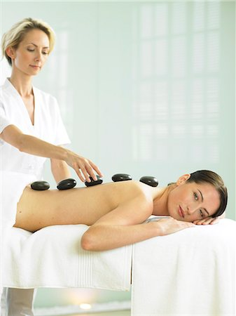 Cropped full length of woman having a stone massage Stock Photo - Rights-Managed, Code: 847-02782365