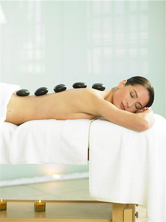 Cropped full length of woman having a stone massage Stock Photo - Rights-Managed, Code: 847-02782366