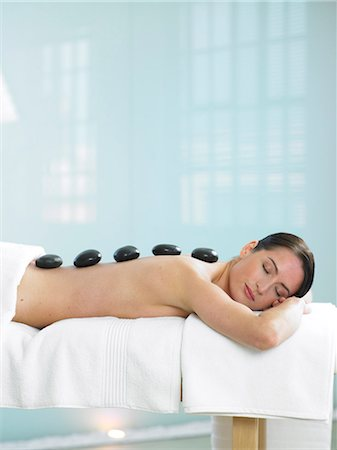 Cropped full length of woman having a stone massage Stock Photo - Rights-Managed, Code: 847-02782369