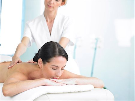 Radiant woman on spa massage bed with therapist Stock Photo - Rights-Managed, Code: 847-02782360