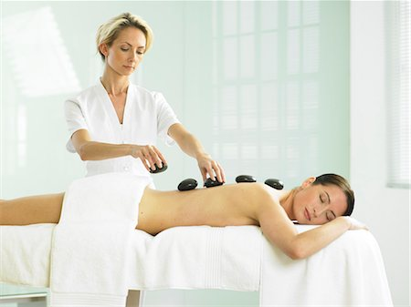 Cropped full length of woman having a stone massage Stock Photo - Rights-Managed, Code: 847-02782361