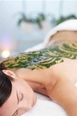 Woman resting with seaweed treatment on back Stock Photo - Rights-Managed, Code: 847-02782397