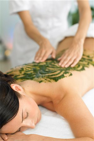 Woman having a seaweed back massage Stock Photo - Rights-Managed, Code: 847-02782404