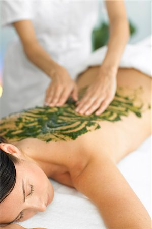 Woman having a seaweed back massage Stock Photo - Rights-Managed, Code: 847-02782405