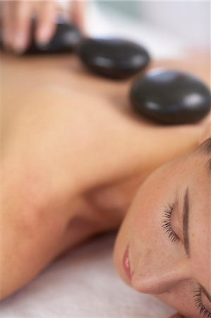 Cropped full length of woman having a stone massage Stock Photo - Rights-Managed, Code: 847-02782454