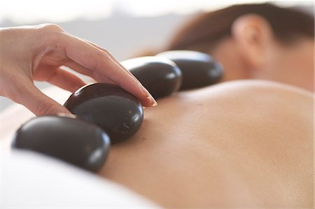 Cropped full length of woman having a stone massage Stock Photo - Rights-Managed, Code: 847-02782457