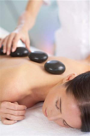 Cropped full length of woman having a stone massage Stock Photo - Rights-Managed, Code: 847-02782450