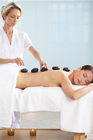 Cropped full length of woman having a stone massage Stock Photo - Rights-Managed, Code: 847-02782460