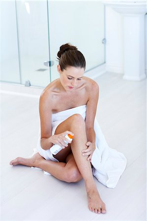 Beautiful  woman applying sun care lotion Stock Photo - Rights-Managed, Code: 847-02782779