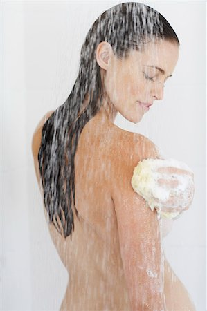 Portrait of beautiful nude woman showering. Stock Photo - Rights-Managed, Code: 847-02782861