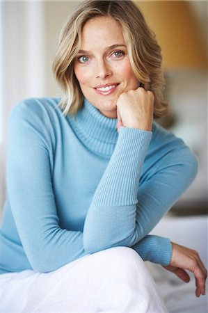 Beautiful mature female wearing blue jumper in beachhouse Stock Photo - Rights-Managed, Code: 847-02783061