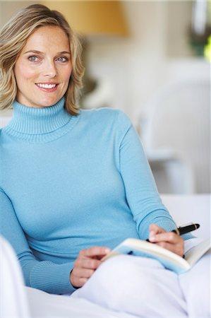 Beautiful mature female writing in beachhouse Stock Photo - Rights-Managed, Code: 847-02783074