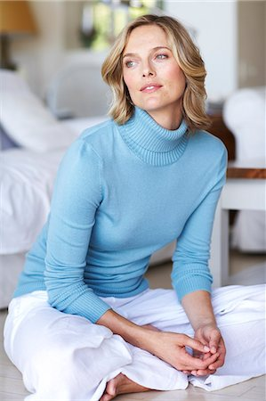 Beautiful mature female wearing blue jumper in beachhouse Stock Photo - Rights-Managed, Code: 847-02783109