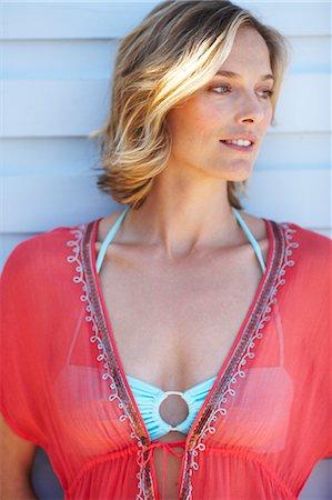 Beautiful mature woman  outside beachhouse Stock Photo - Rights-Managed, Code: 847-02783150