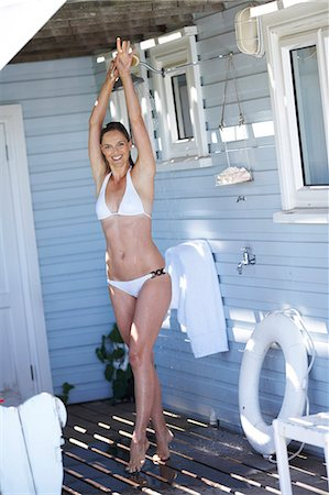Beautiful mature woman showering at the beachhouse Stock Photo - Rights-Managed, Code: 847-02783297