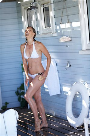 Beautiful mature woman showering at the beachhouse Stock Photo - Rights-Managed, Code: 847-02783292