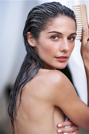 Beautiful woman combing wet hair Stock Photo - Rights-Managed, Code: 847-02800855