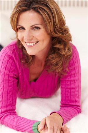 Mature woman relaxing on bed Stock Photo - Rights-Managed, Code: 847-03227295