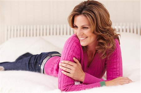 Mature woman relaxing on bed Stock Photo - Rights-Managed, Code: 847-03227293