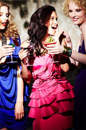 Three young women enjoying cocktails Stock Photo - Rights-Managed, Code: 847-03227454