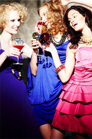 Three young women enjoying cocktails Stock Photo - Rights-Managed, Code: 847-03227457