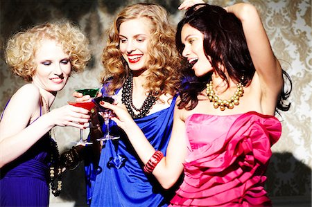 Three young women enjoying cocktails Stock Photo - Rights-Managed, Code: 847-03227458