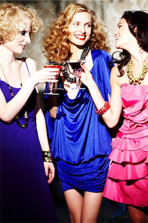 Three young women enjoying cocktails Stock Photo - Rights-Managed, Code: 847-03227459