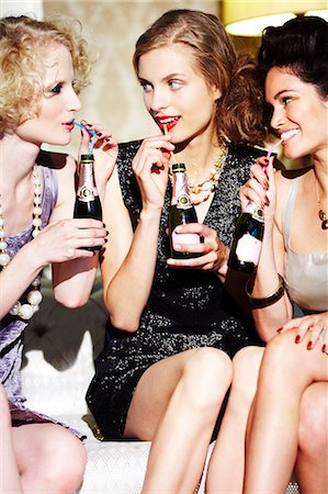 Three young women enjoying champagne Stock Photo - Rights-Managed, Code: 847-03227464