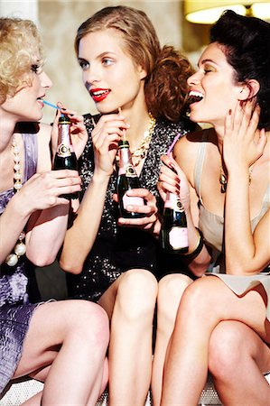 Three young women enjoying champagne Stock Photo - Rights-Managed, Code: 847-03227465