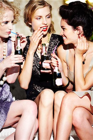 Three young women enjoying champagne Stock Photo - Rights-Managed, Code: 847-03227466