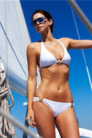 Girl in white bikini standing on sailing boat Stock Photo - Rights-Managed, Code: 847-03652375