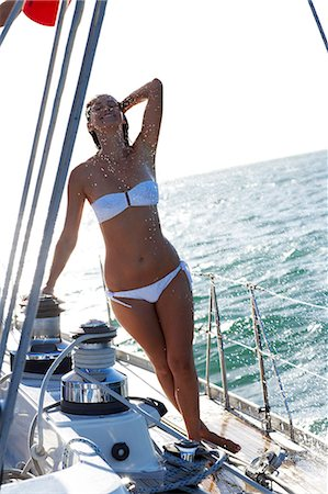 Girl showering on deck of yacht in white bikini Stock Photo - Rights-Managed, Code: 847-03652451