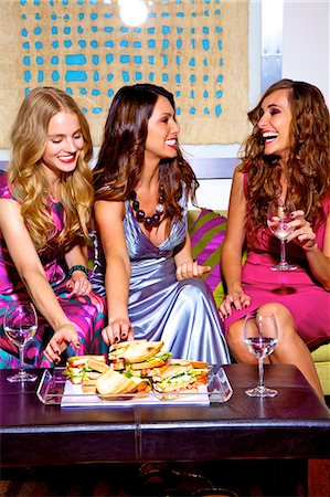 Three beautiful women chatting with food and wine Stock Photo - Rights-Managed, Code: 847-03719753