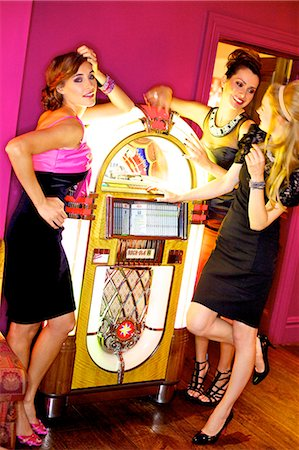 sexy women legs - Three beautiful women next to a jukebox Stock Photo - Rights-Managed, Code: 847-03719774