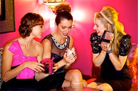 Three beautiful women giving gifts in a bar Stock Photo - Rights-Managed, Code: 847-03719773