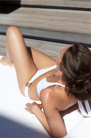 Beautiful lady lying down in villa wearing bikini Stock Photo - Rights-Managed, Code: 847-03758013
